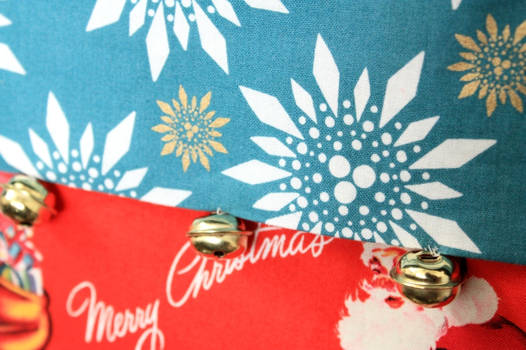 Close-up of jingle bells on Olive's stocking
