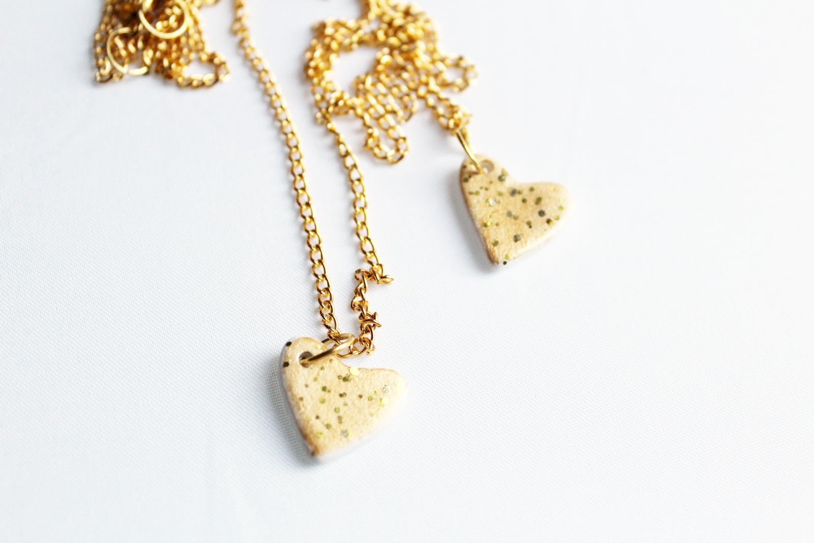 Gold dust ceramic heart necklaces