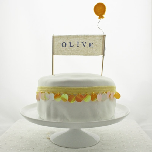 Olive banner - yellow balloon - spangle cake - full length - hi res 2