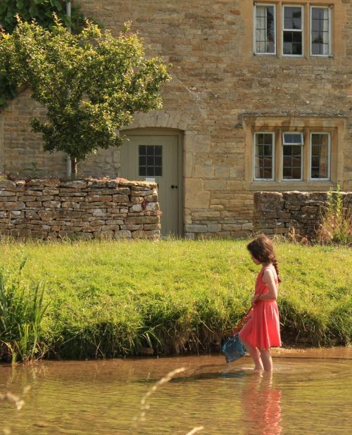 Girl fishing in stream Lower Slaughter