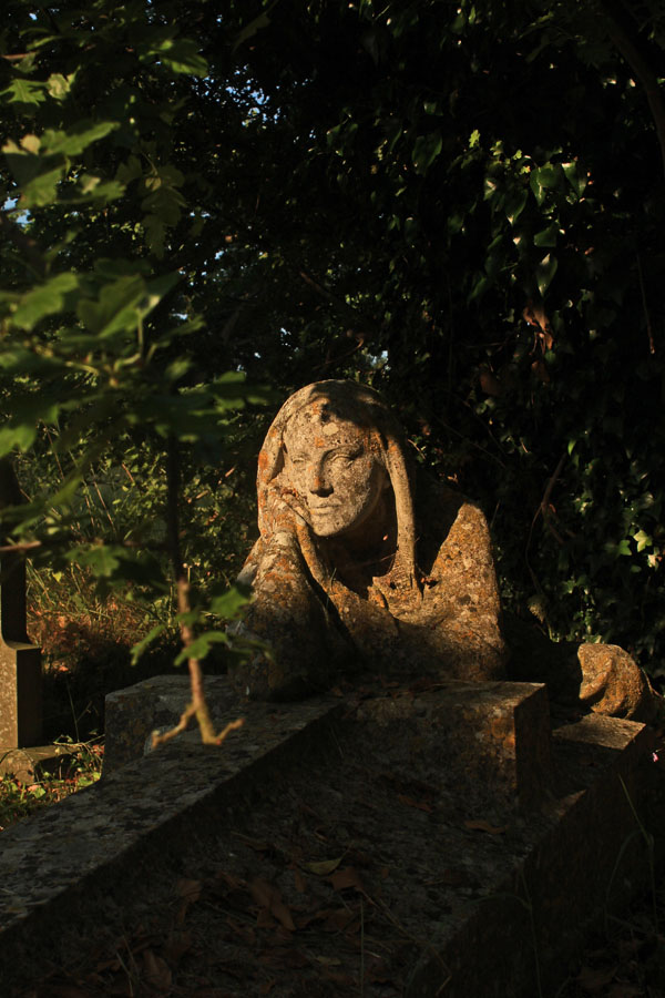 Madonna keeping watch over grave