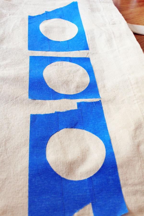 Masking tape stencils on bag