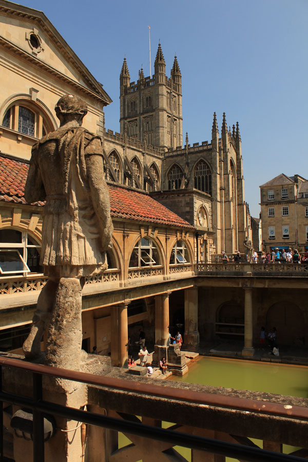 Roman baths at Bath with statue and abbey