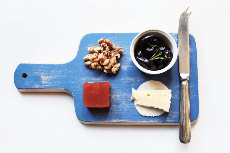 Blue cheese platter with walnuts, olives, quince paste, brie