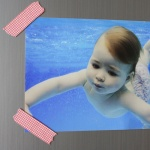 Photo of underwater baby with washi tape magnets