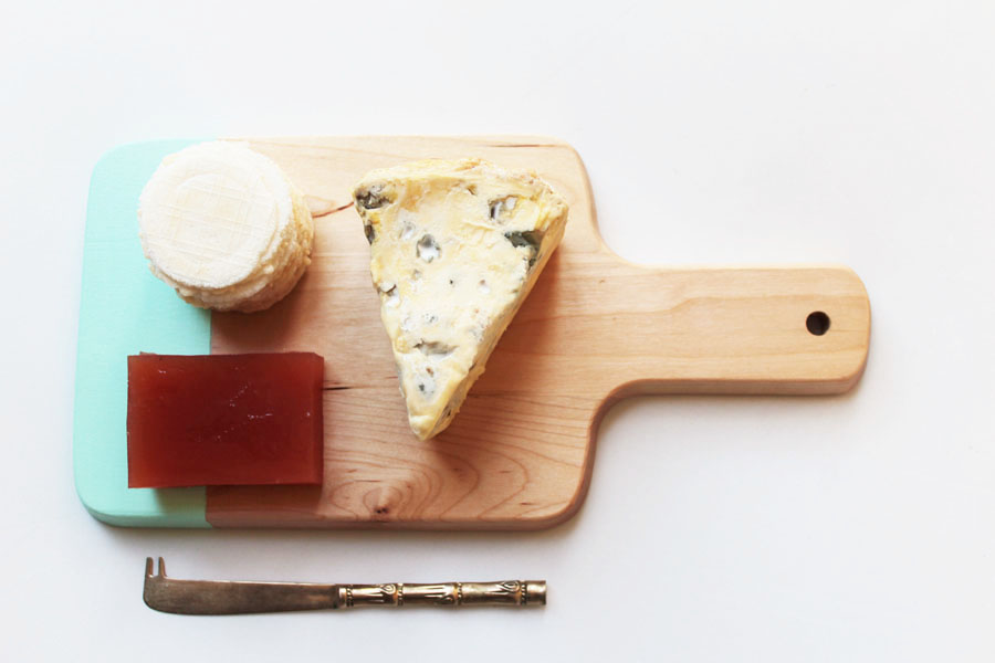Small aqua edged cheese platter gold knife below
