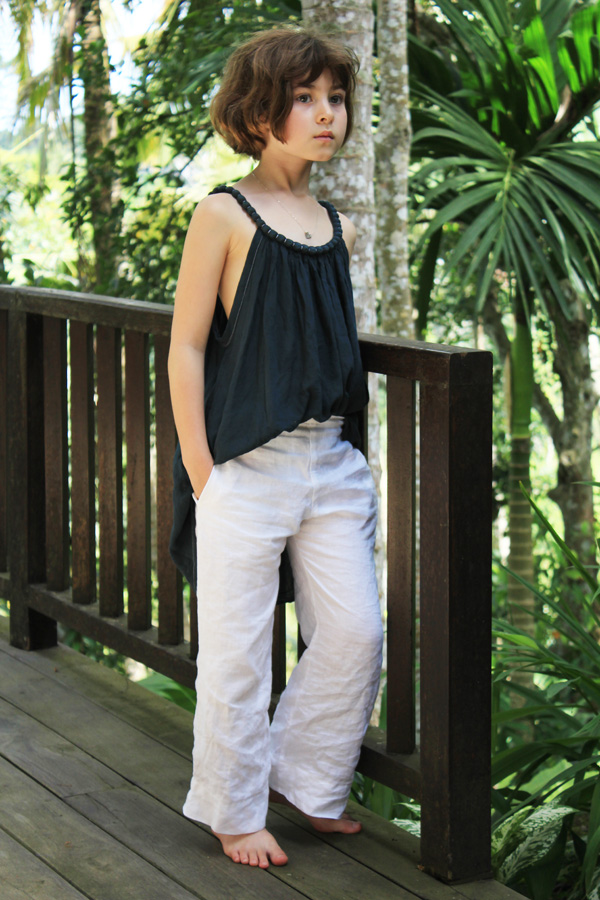 Soph in flat fronted white linen pants