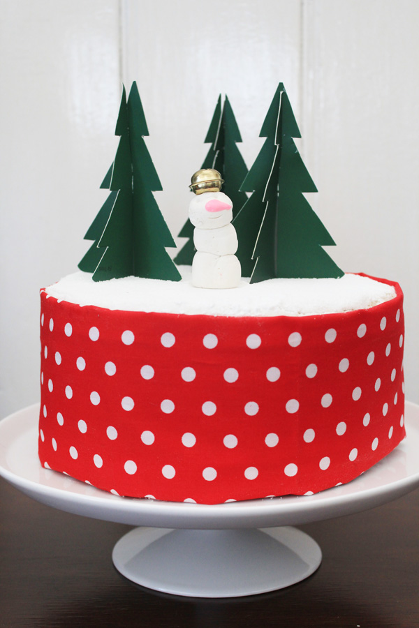 Christmas cake with snowman and pine trees