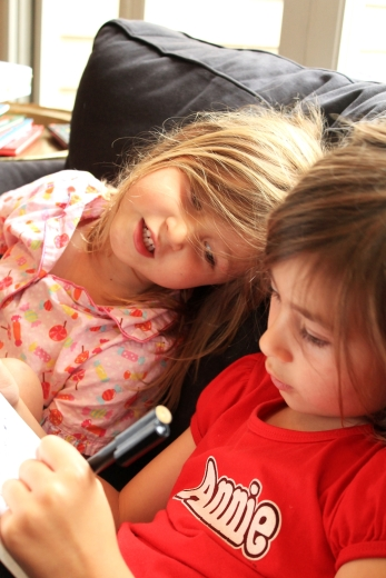 Girls writing letters to Father Christmas