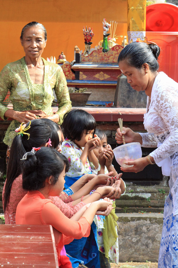 Kids getting blessings at the temple
