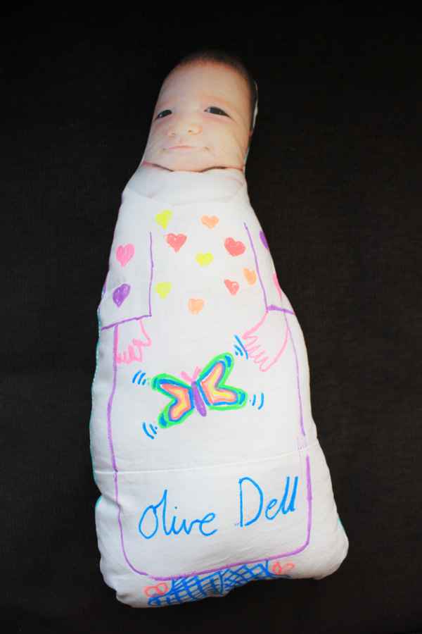 Olive doll sibling present