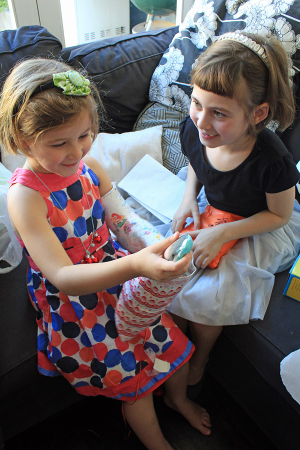 Olive opening her sibling present