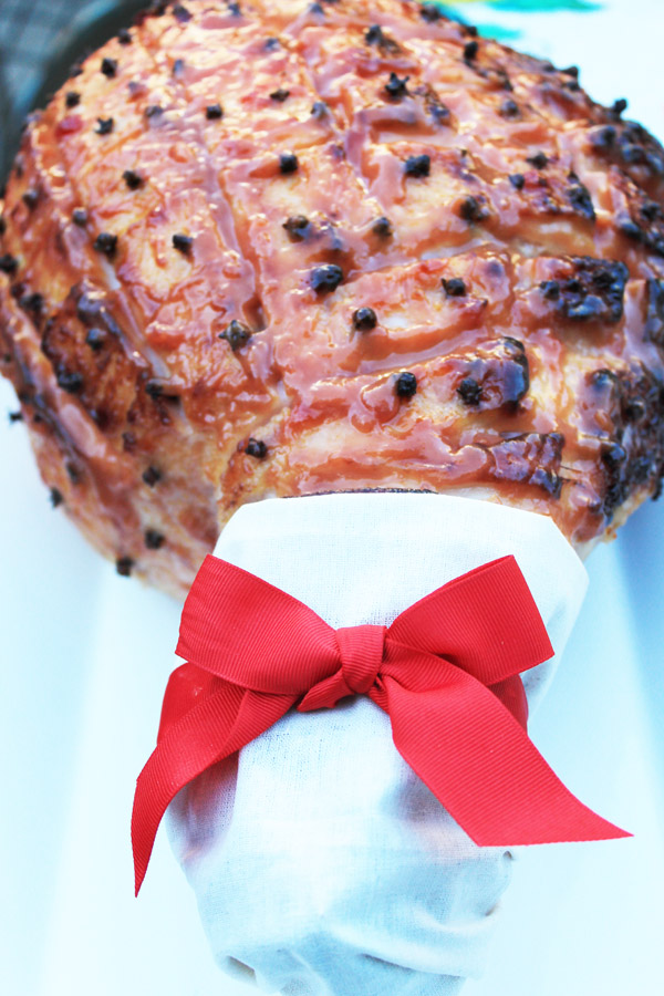 whole baked ham with calico handle