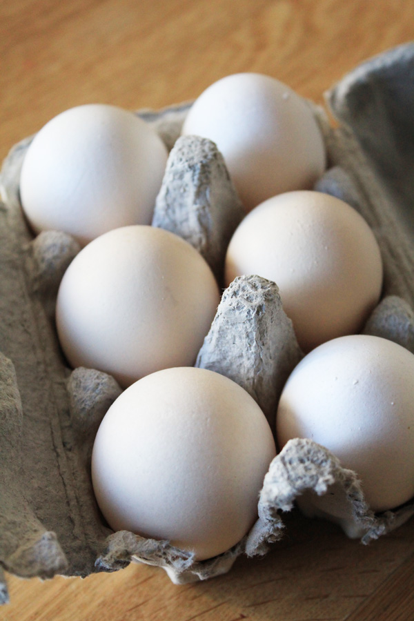 Six 6 white eggs in  carton